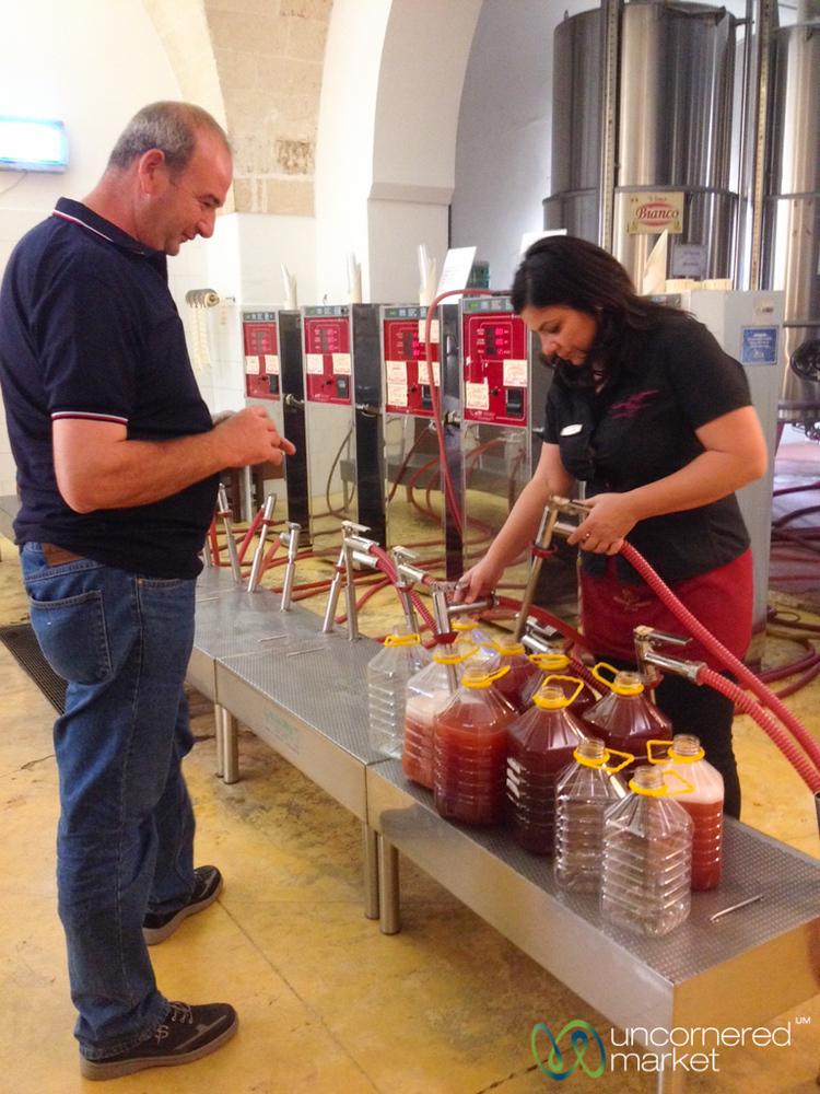 Pumping Wine at Produttori Vini Manduria - Puglia, Italy