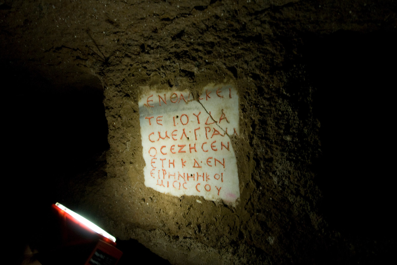Ancient writings on the wall of an archaeological site in Rome, Italy