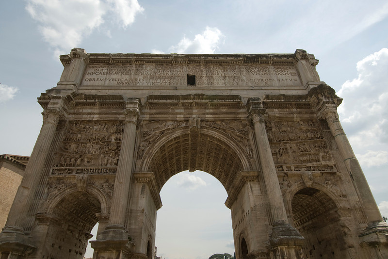 Isolated shot of the Arch of Titus in Roman Forum - Rome, Italy