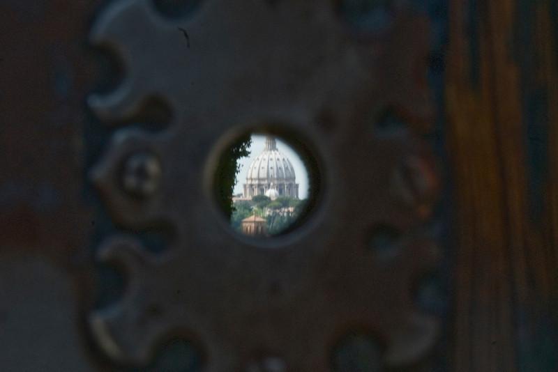 View of the St. Peter's Basilica dome through a keyhole in Villa Malta & Garden - Rome, Italy