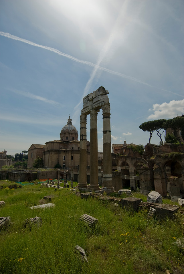 Isolated shot of ruined pillars at Roman Forum in Rome, Italy