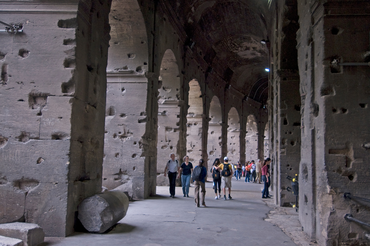 Tourists exploring around the Colosseum in Rome, Italy