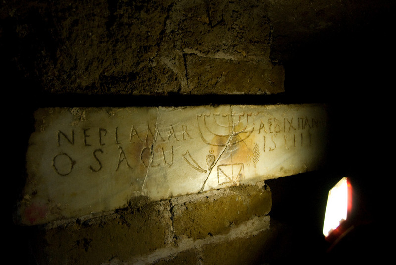 Writings on the wall at archaeological site in Rome, Italy