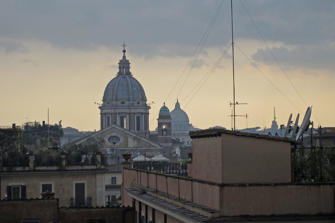 Church dome and roofs of houses over skyline in Rome, Italy