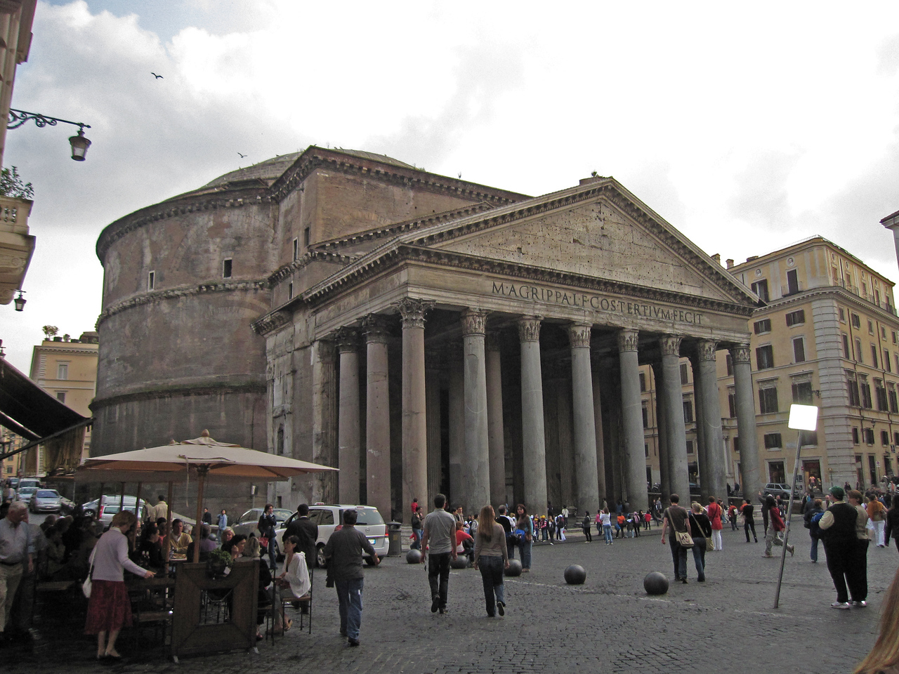 Stalls and tourists outside the Pantheon in Rome, Italy