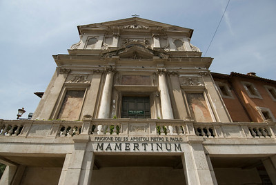Looking up the facade of Mamertine Prison in Rome, Italy