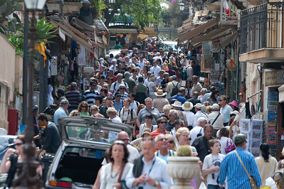 Open air street market filled with tourists in Sicily, Italy