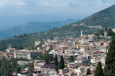 View of rooftops and mountain ranges in Sicily, Italy