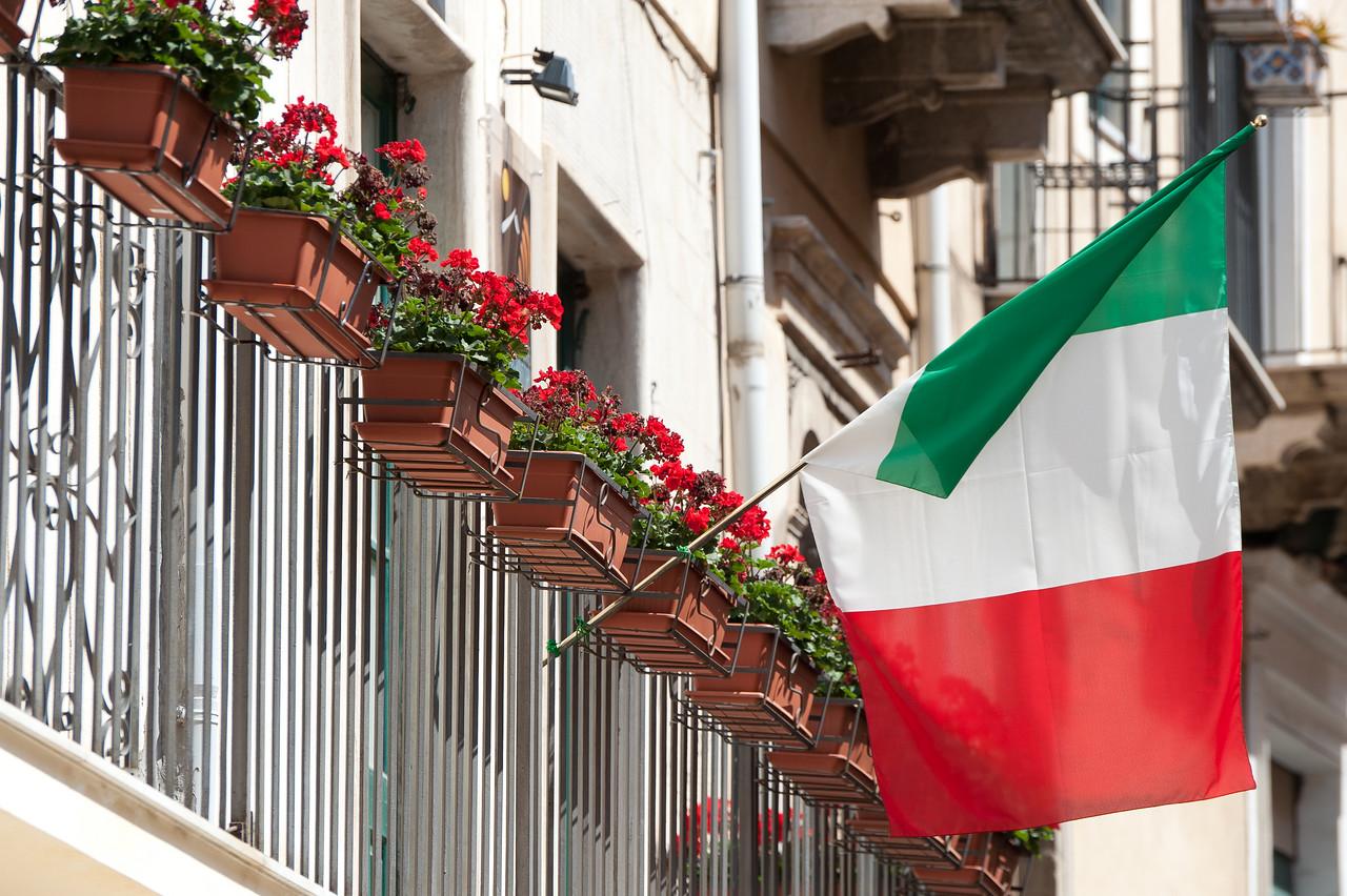 Italy's National flag waving on a balcony - Sicily, Italy