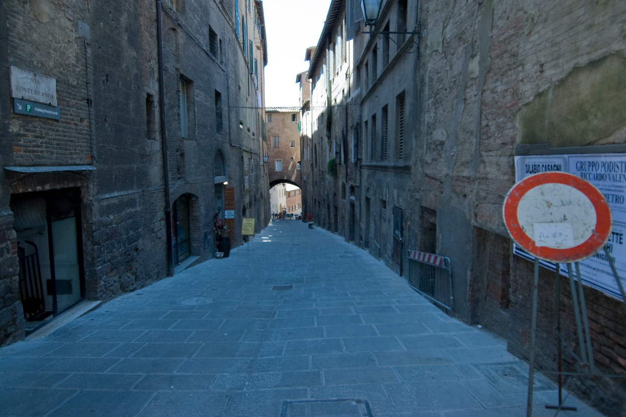 Empty alley in Siena, Italy