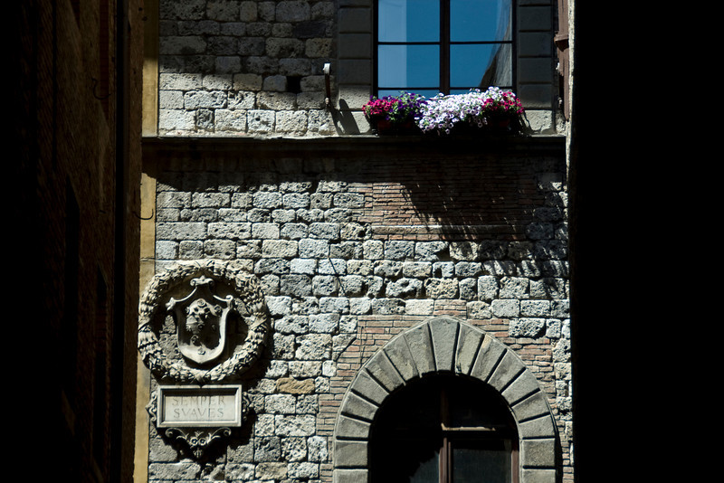 Old brick stone building in Siena, Italy