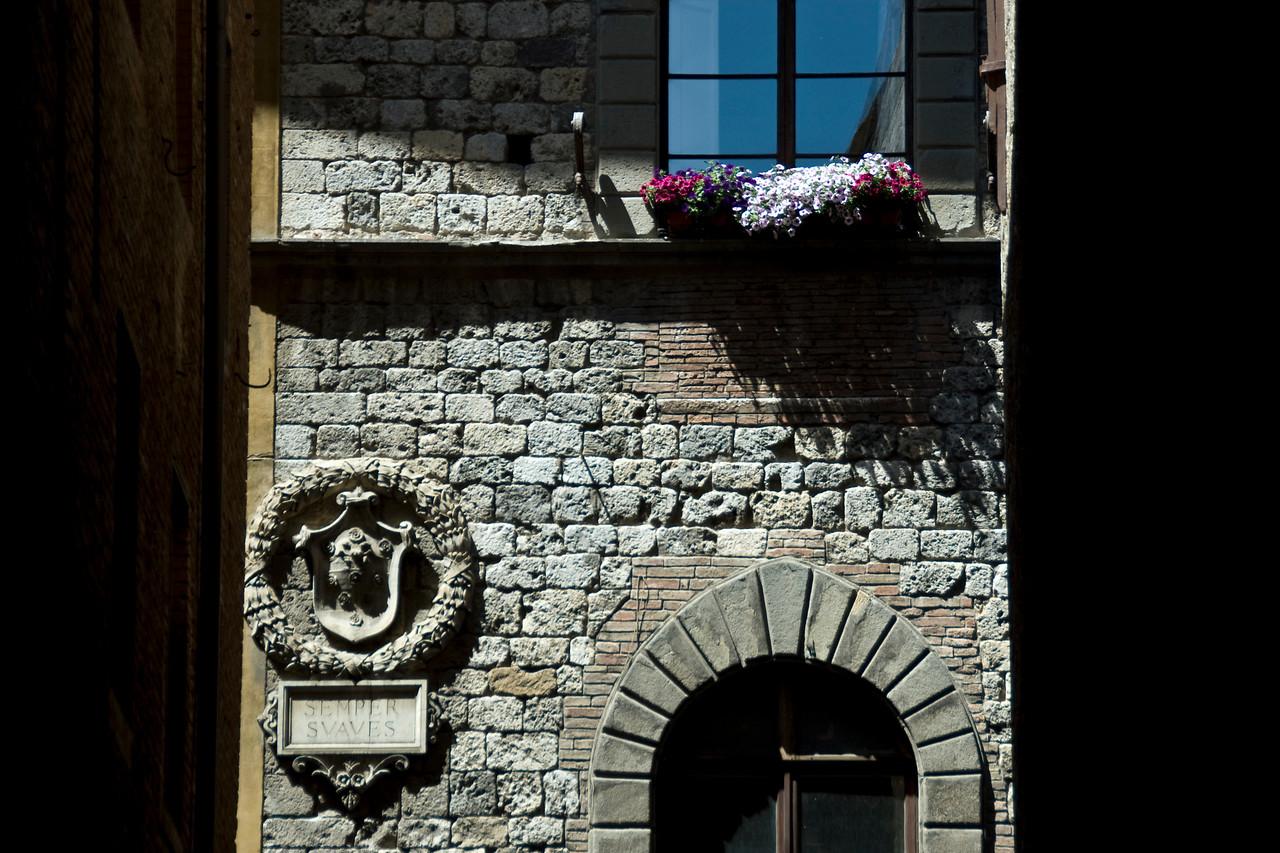 Old brick stone building in Siena, Italy
