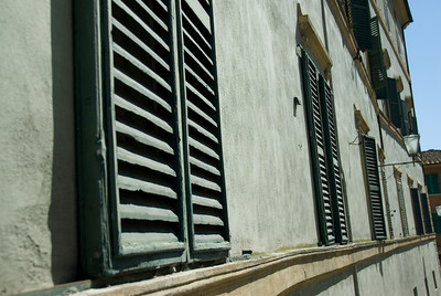 Wooden windows on a building in Siena, Italy