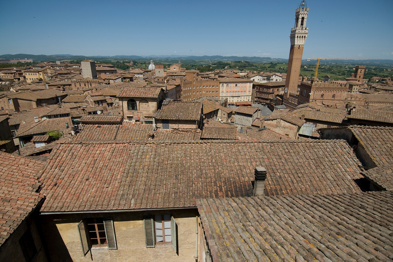 View of Piazzo del Campo and Palazzo Pubblico Town Hall in Siena, Italy