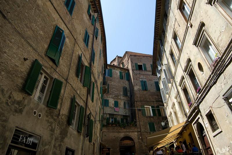 Buildings in an alley in Siena, Italy