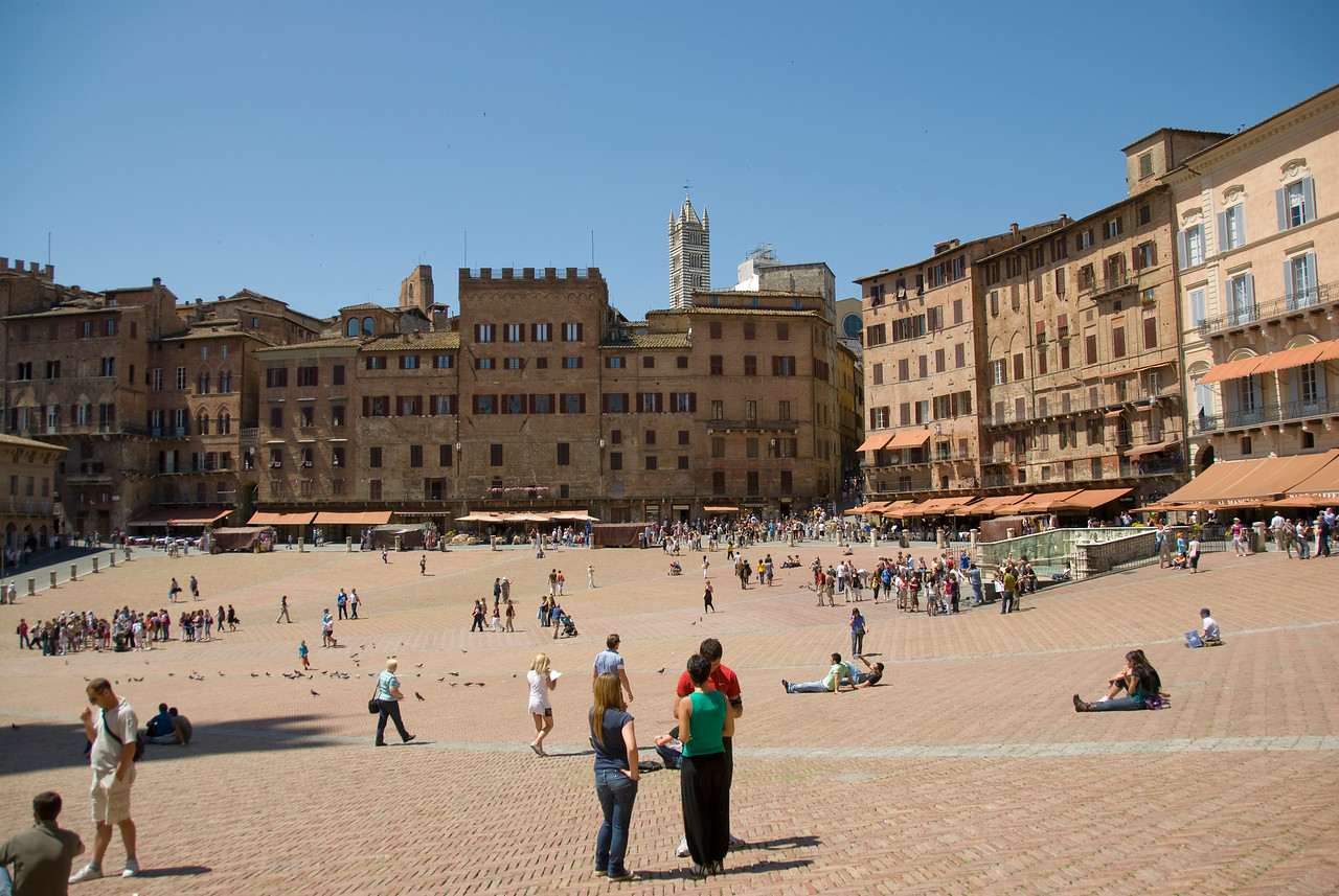 Tourists spending idle time at Piazza del Campo in Siena, Italy