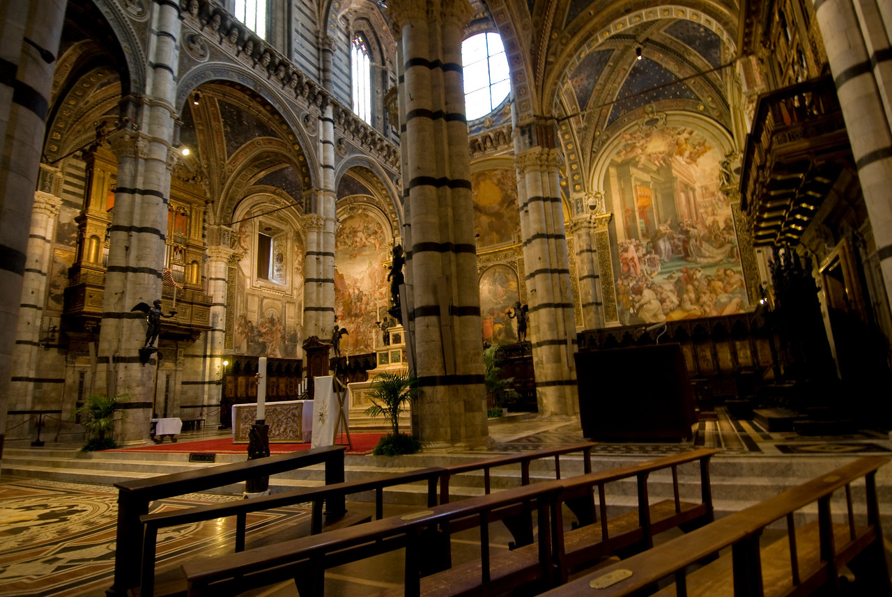 Pillars and pews inside Siena Cathedral in Italy