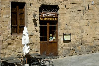 Wooden door of a restaurant in Siena, Italy