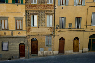 Colorful traditional buildings in Siena, Italy