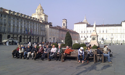 People sitting in the square by Palazzo Madama