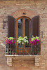 "Picturesque window in <a target=""NEWWIN"" href=""http://en.wikipedia.org/wiki/San_Gimignano"">San Gimignano</a>, Tuscany"
