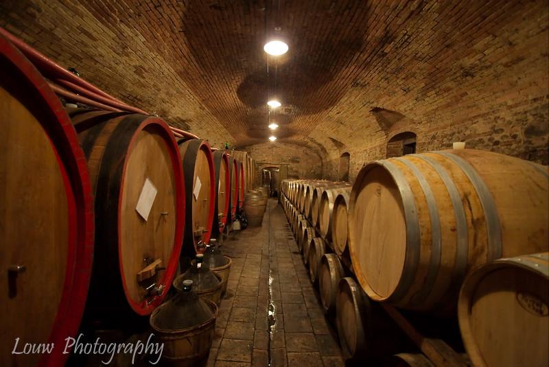 "Wine barrels at <a target=""NEWWIN"" href=""http://www.fattoriadifiano.it/"">Fattoria di Fiano</a>, Tuscany"