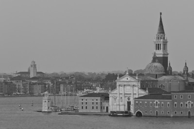 Bell tower on the Giudecca over city skyline - Venice, Italy
