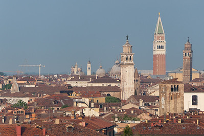 A trio of towers in Venice: Carmini Church Bell Tower, St. Mark's Bell Tower and Bell Tower of San Giacomo in Murano Island - Italy