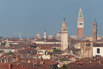 A trio of towers in Venice: Carmini Church Bell Tower, St. Mark's Bell Tower and Bell Tower of San Giacomo in Murano Island - Italy