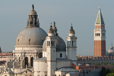 Domes of Santa Maria della Salute and St. Mark's Bell Tower over skyline in Venice, Italy