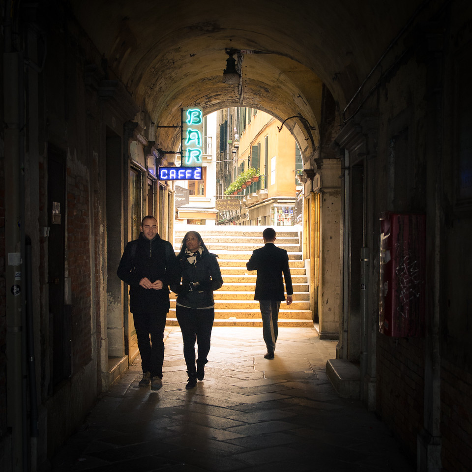 People in a passage off of St. Mark's Square.