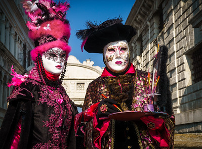 Vivid colors in this carnival life scene and nice choice of theme for this French couple.