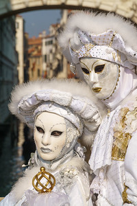 Nice couple with white/gold carnival costume blending so nicely with the Venetian background.