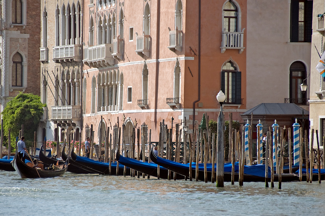 Posts at parking spots for gondolas in Venice, Italy
