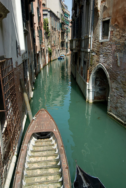 Riding the gondola through narrow alleys in Venice, Italy
