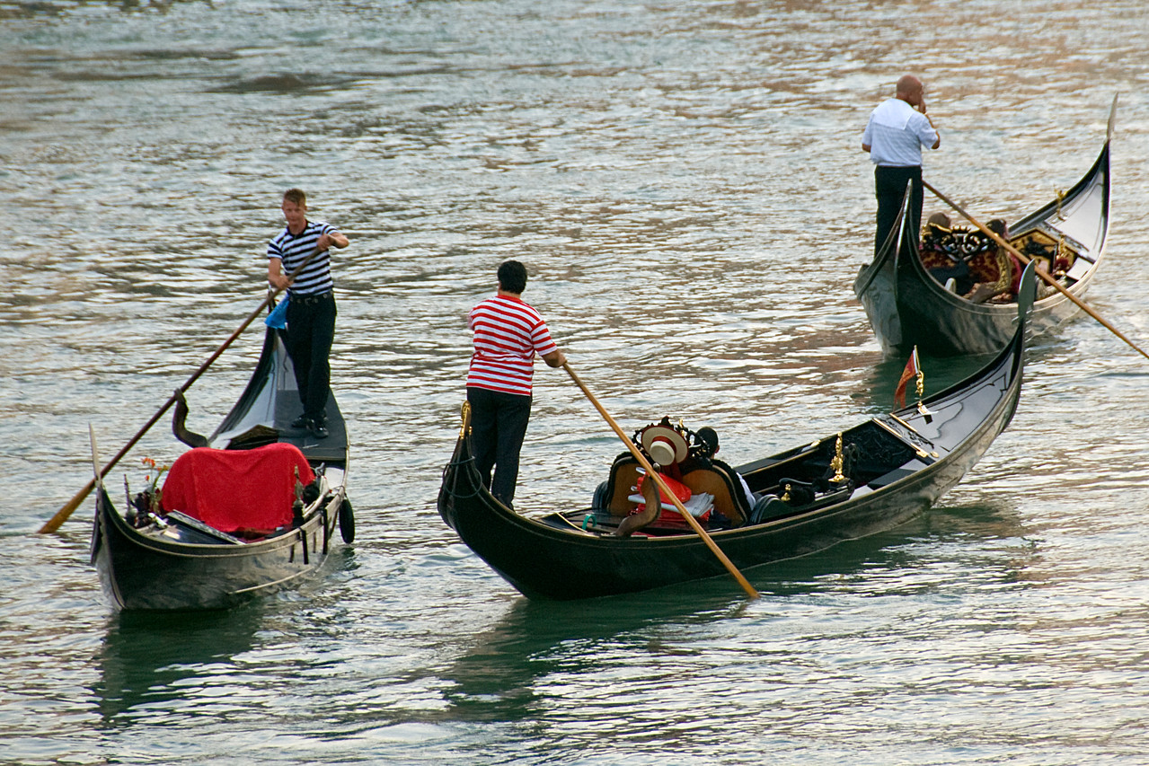 Tourists riding the gondolas over the Grand Canal in Venice, Italy
