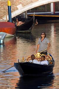 Tourists riding the gondola in Venice, Italy