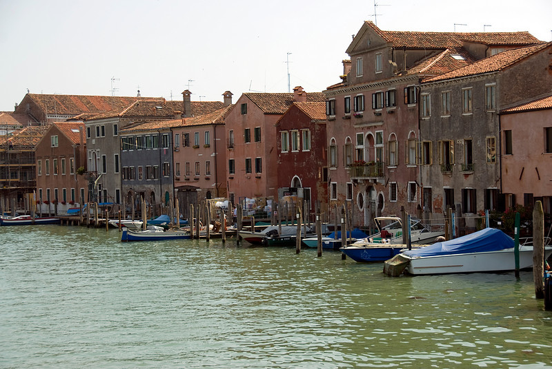 Water taxis parked near buildings at Grand Canal in Venice, Italy