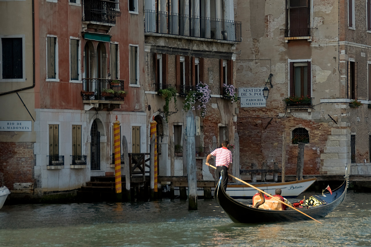 Gondola cruising tourists across the Grand Canal in Venice, Italy