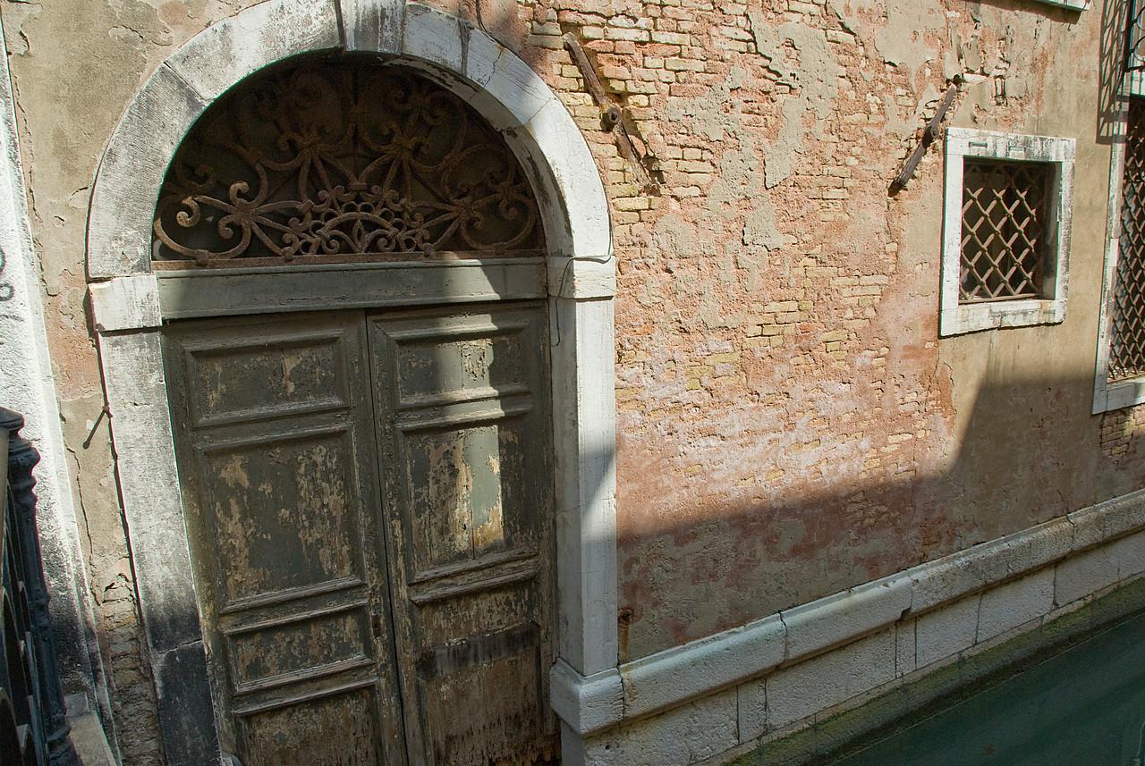 Steel door to an old building in Venice, Italy