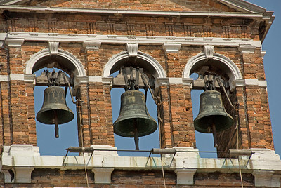 Church belfry with three bells in Venice, Italy