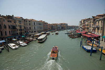 Gondolas cruising over the Grand Canal in Venice, Italy
