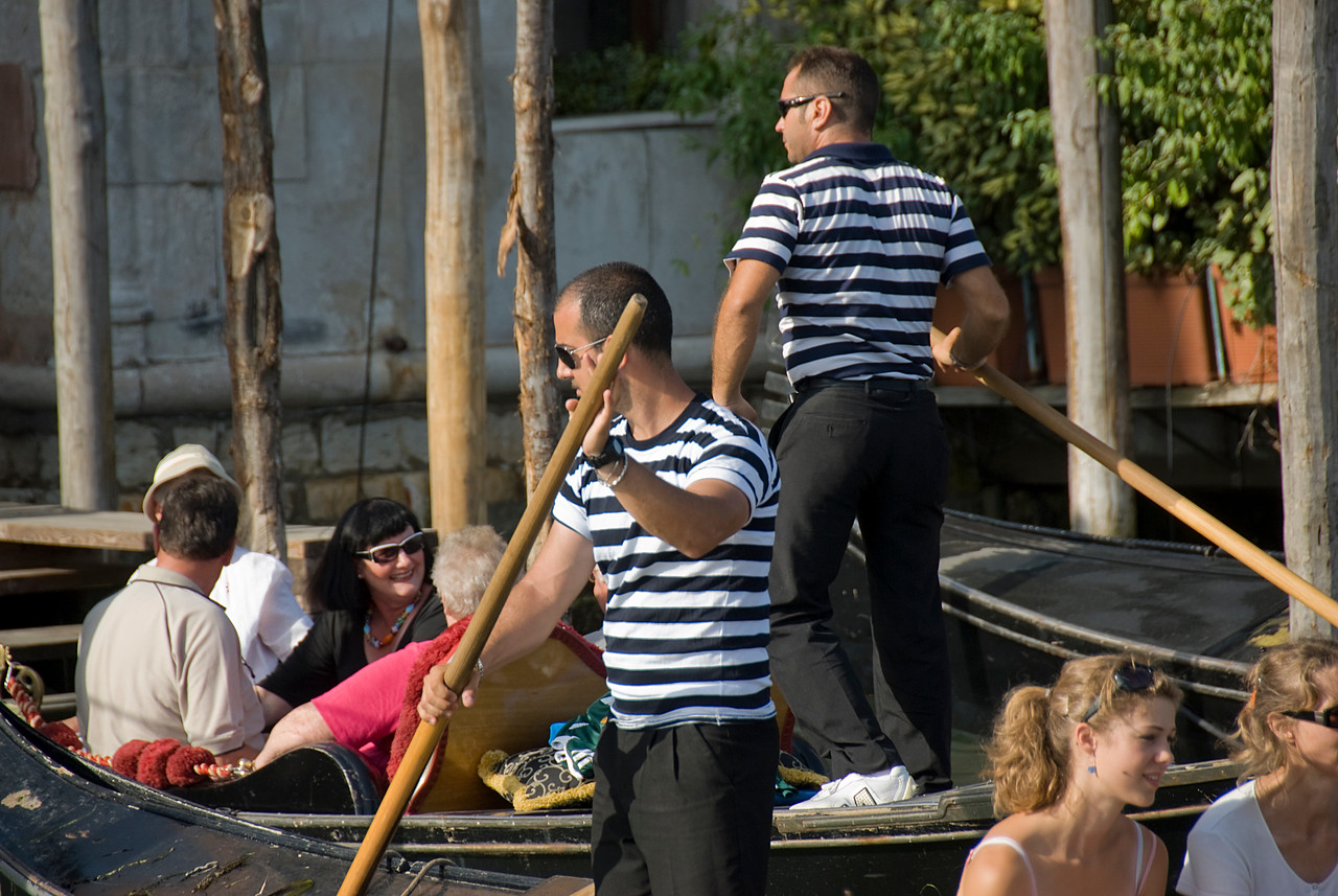 Gondoliers wearing black & white stripes - Venice, Italy