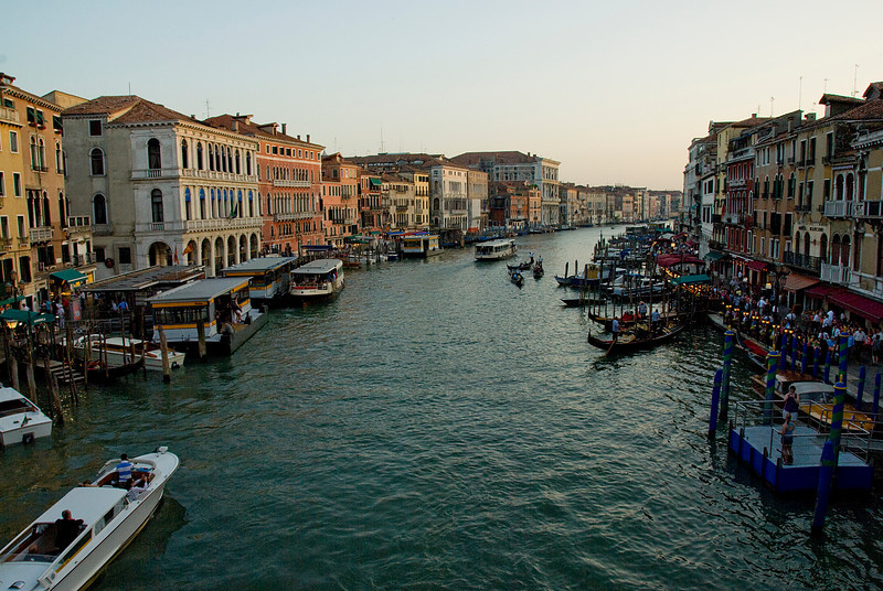 Overlooking view of the Grand Canal, water taxis and gondolas in Venice, Italy
