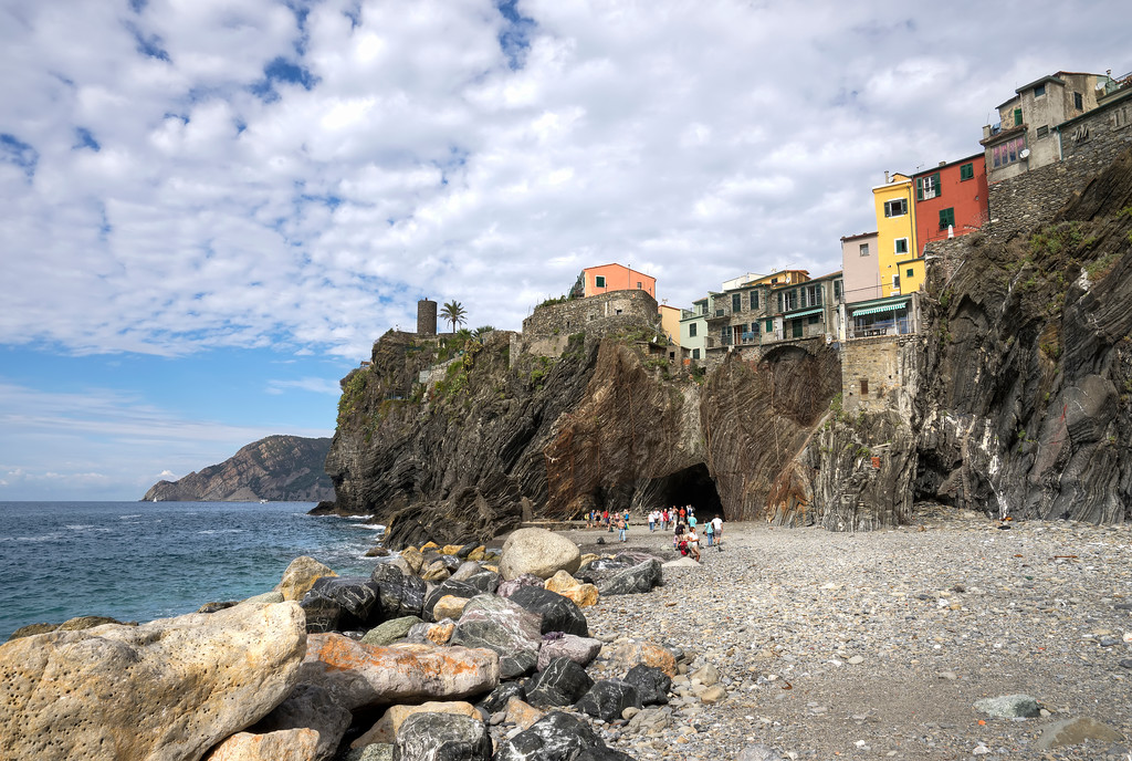 vernazza beach caused by landslide colourful houses on top of cliff and ocean