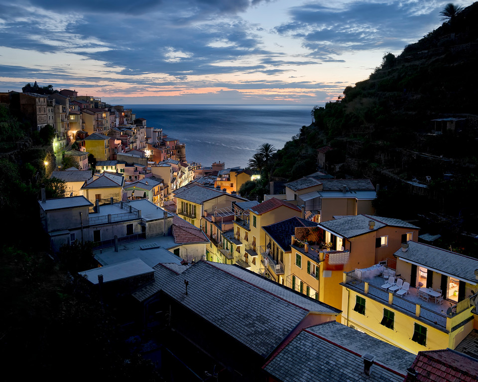 manarola at night with lights one view from la toretta hotel