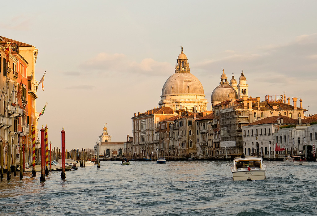 Venice grand canal at sunset with water taxi and dome church