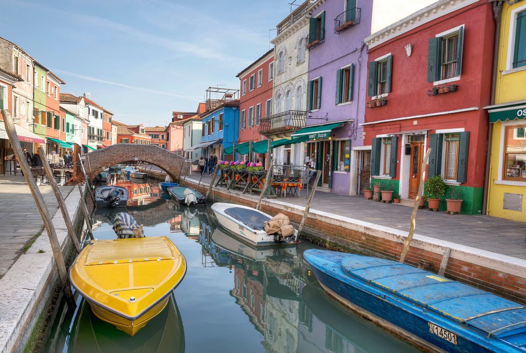 colourful canal with boats in Burano venice italy europe