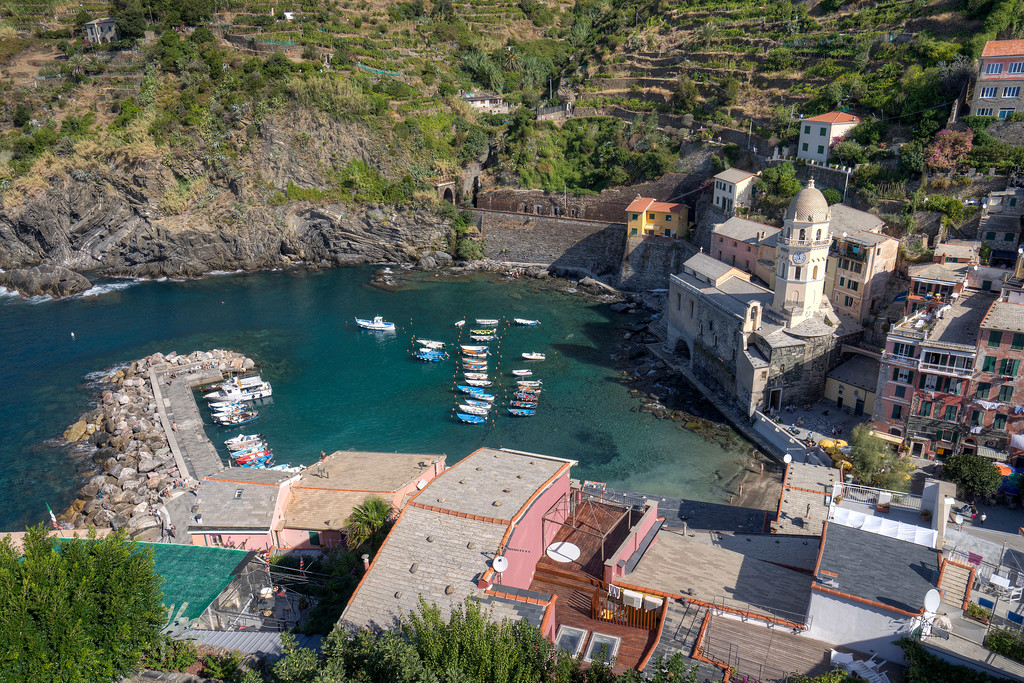 vernazza harbour with boats and azure water quaint italian fishing village