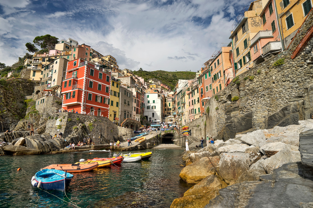 riomaggiorie harbour with boats and dramatic sky cinque terre italy
